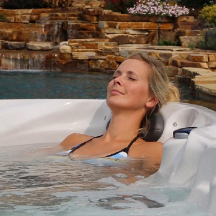 Woman Relaxing in spa hot tub